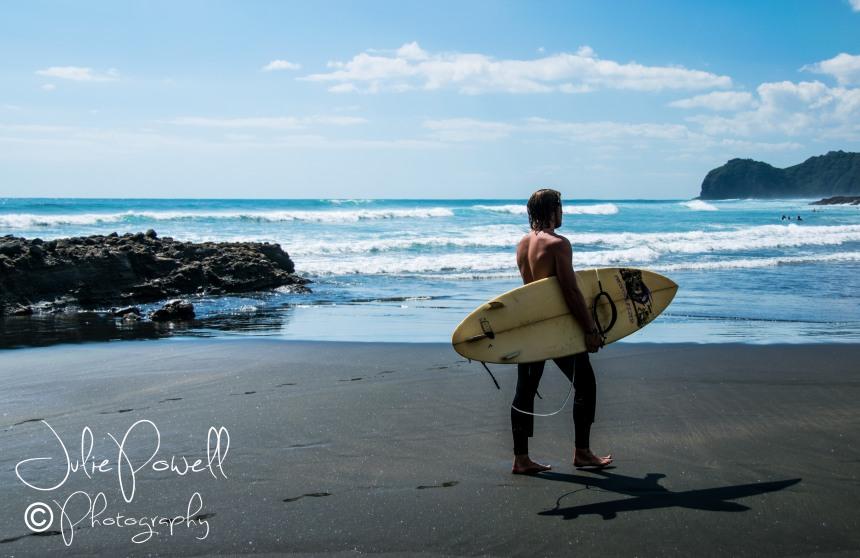 Surfer at Piha Beach