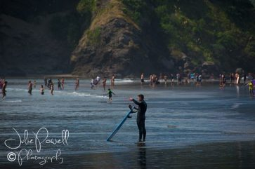 Surfer at Piha Beach